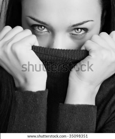 Black and white girl with half face tighting pullover - stock photo