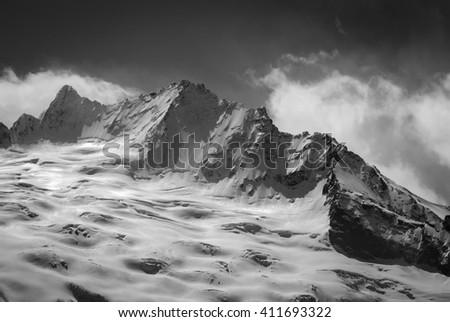 Black and white glacier in winter. Caucasus Mountains, region Dombay. - stock photo