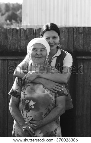 Black and white Grandmother in a scarf with her granddaughter