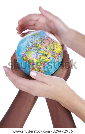 Black and white hands around a globe isolated
