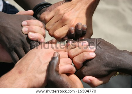 Black and white hands joined together - stock photo