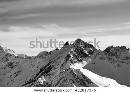 Black and white high mountains in winter. View from mount Elbrus, Caucasus Mountains. - stock photo