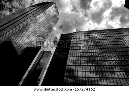 Black and white Houston Texas downtown mirror buildings detail - stock photo