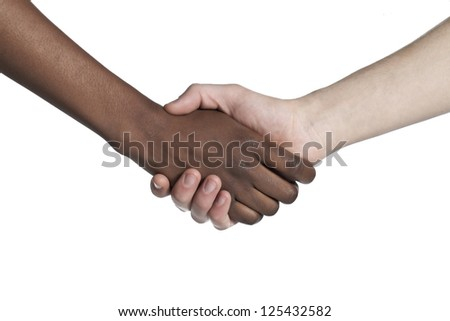 Black and white human hands doing a hand shake to show their friendship - stock photo