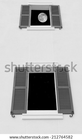 Black and White illustration of Shuttered windows showing the moon and stars - stock photo