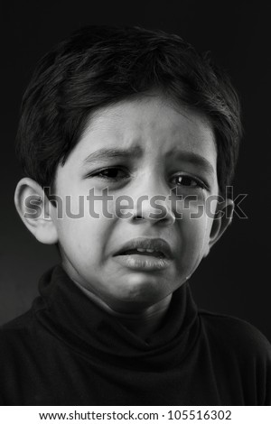 Black and white image of a crying kid - stock photo