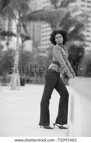 Black and white image of a young woman in fashionable clothing - stock photo