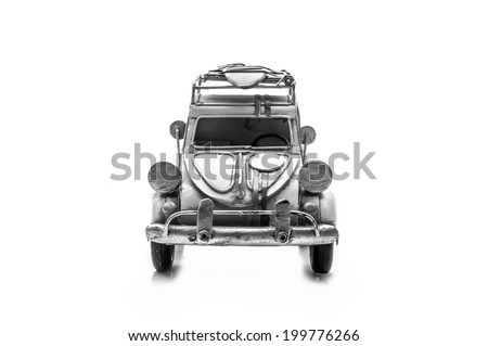 black and white image of Ancient toy car isolated on white back ground - stock photo