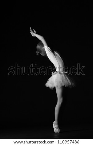Black and White image of dancer over dark background - stock photo