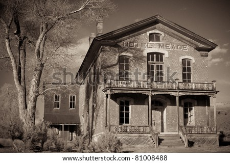 Black and white image of the large Hotel Meade at Bannack Ghost Town, Montana.