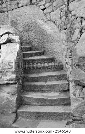 Black and White image of worn stone steps. - stock photo