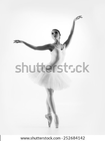 Black and white image of young beautiful ballet dancer isolated over white background - stock photo