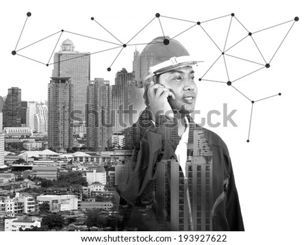 Black and white image the engineer with cityscape background (Conceptual Surreal Style) - stock photo