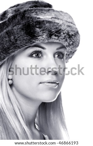 Black and white images of a woman wearing a fur hat
