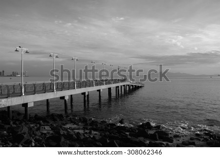 black and white jetty on the sea - stock photo