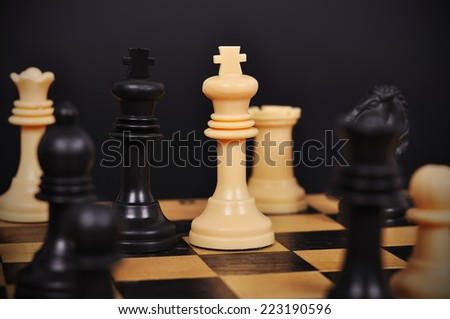 Black and White King on chess board, close up - stock photo
