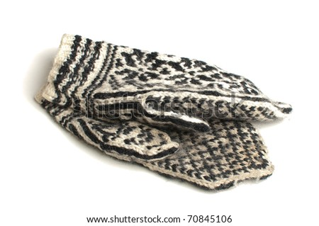 Black and white knitted mittens over white background - stock photo
