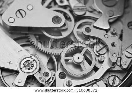 Black and white macro photo close-up view of metal clockwork. Concept eternity, teamwork - stock photo