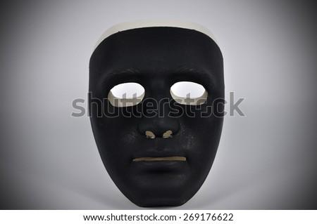 Black and white masks like human behavior, conception - stock photo