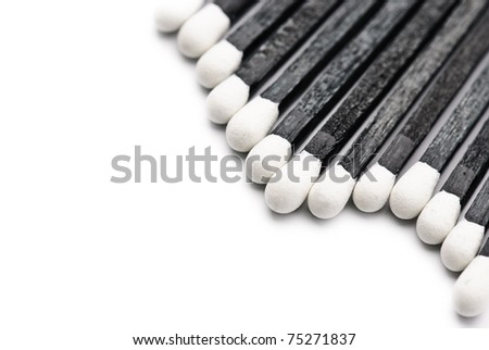 Black and White Matches isolated against a white background - stock photo