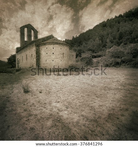 Black and white medium format film shot. Added texture and soft color toning effect. Romanesque hermitage from XII century at Girona -Catalonia - Spain.   - stock photo