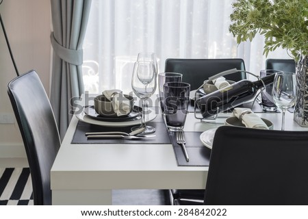 black and white modern dinning table with table set at home