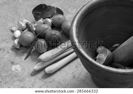 Black and white mortar and pestle, thai cooking tool - stock photo