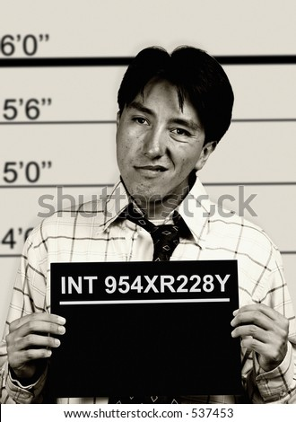 black and white mugshot of a man - stock photo