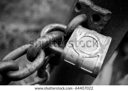 Black and white of a padlock and chain - stock photo