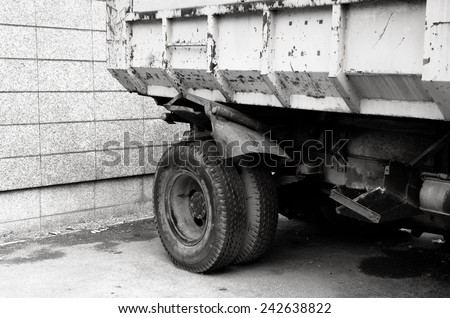Black and White of a truck with rear wheel / Truck with rear wheel