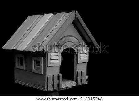 Black and White of bird house. - stock photo