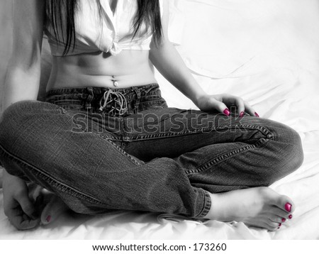 Black and white of Female figure sitting cross legged, tinted nails - stock photo