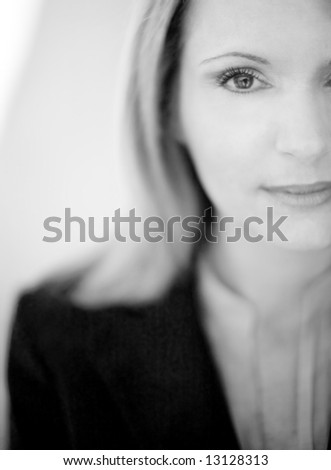 black and white of professional businesswoman dressed in shirt and suit?