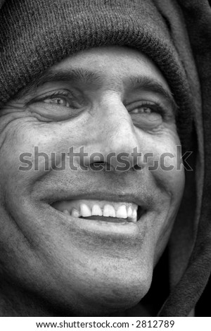 Black and White of smiling man wearing winter cloths