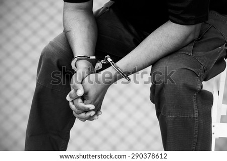 black and white of the man was bound by hand in the handcuffed out of freedom - stock photo