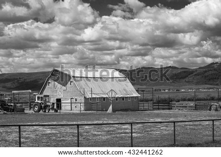 Black and white old barn in rural Wyoming, USA. - stock photo