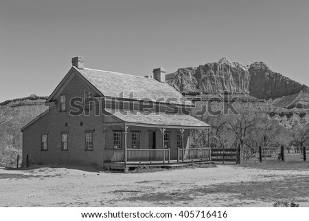 Black and white old farm house in the Utah desert, USA.