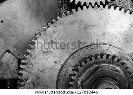 Black and white old gear of lathe machine background - stock photo