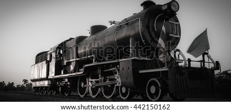 Black and white old steam locomotive in Thailand. - stock photo