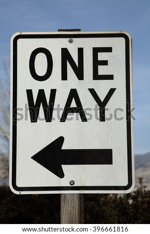 Black and white one way road sign
