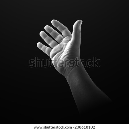 Black and white open empty one hand with palms up. Christmas background, Forgiveness, Mercy, Humble, Repentance, Reconcile, Adoration, Glorify, Redeemer, Redemption, Gospel, Love, Faith, Hope concept. - stock photo