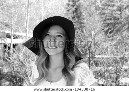 Black and White outdoor portrait of a cute young woman.