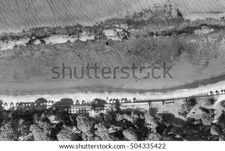 Black and white overhead view of beautiful beach.