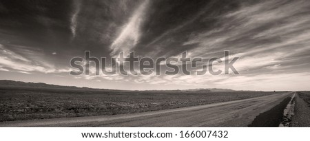 Black and white panorama of steppe road in Kazakhstan