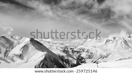 Black and white panorama of winter snowy mountains. Caucasus Mountains, Georgia.  - stock photo