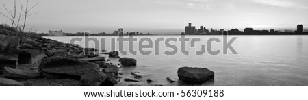 Black and white panoramic image of the Ambassador Bridge connecting Detroit, Michigan and Windsor, Ontario at sunset over the Detroit River from Belle Isle - stock photo