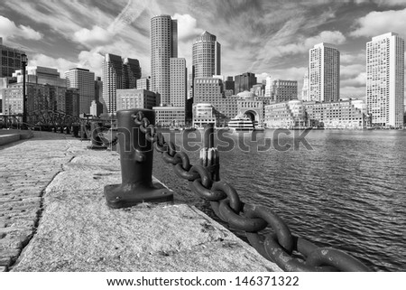 Black and White panoramic photo of Boston Harbor and Financial District in Massachusetts, US on a sunny summer day. - stock photo