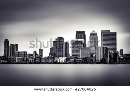 Black and White panoramic view of Canary Wharf, the financial district in London. - stock photo