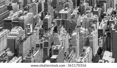Black and White Panoramic view of tall crowded buildings in Manhattan, New York City - stock photo