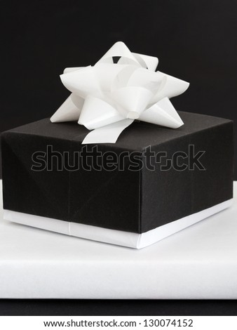 black and white paper gift box before black and white background - stock photo